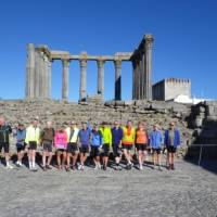Cycle group in front of an ancient ruin in the Alentejo