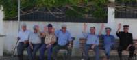 Cycling by friendly men resting on park benches in the Alentejo