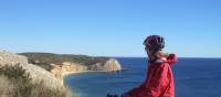 Cyclist admiring the coastline on day 5 of the Algarve Cycle