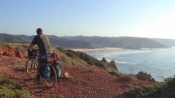 Explore Portugal's Algarve by bike to access quieter beaches away from the crowds