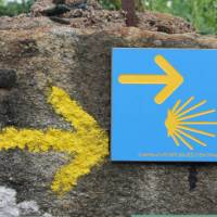 Portuguese Camino sign showing the way to Santiago de Compostela in Spain   Jaclyn Lofts