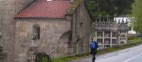 Walking through a quiet village along the Camino in Portugal