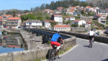 Cyclists entering a village on the Portuguese Camino