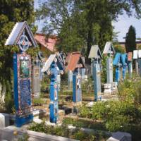 The Happy Cemetery where wood sculptured headboards are painted to depict the most important times in the lives of the deceased