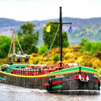 The comfortable floating hotel barge, Fingal, approaching Inverness