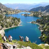 Hikers ascending above the lakes in the Aigues Tortes