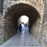 Laneway in the medieval village of Peratallada, visited on a self guided cycle trip in Catalonia | Kate Baker