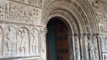The impressive Benedictine Monastery in Ripoll with its stone carved doorway. | Kate Baker