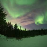 Swirling northern lights in Swedish Lapland | Ross Baker