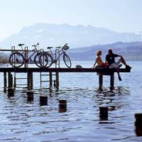 Swiss Chocolate Cycle #3 Cyclists on jetty in lake