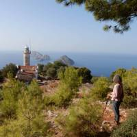 Hiker enjoying the view of Cape Gelidonia lighthouse and the 'Five Islands'   Lilly Donkers