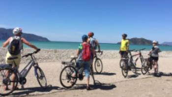 Pedalling along the empty stretches of Fethiye Beach in Turkey