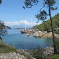 Boat moored at the ruins of 'Cleopatra's baths' on our Turkey Walk & Sail | Kate Baker