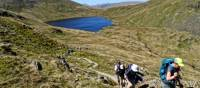 Hikers above Grizedale Tarn in the Lake District   John Millen