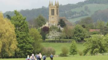 A group of walkers arrives in Broadway in the Cotswolds
