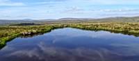 Moorland reflections in a tarn | John Millen