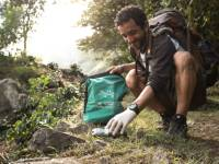 Traveller collecting litter along wilderness trails, part of our 10 Pieces litter collection program |  <i>Mark Tipple</i>