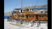 Explore the magical Ionian and Aegean Islands on a Greek Islands Bike & Boat holiday with UTracks. Cycle to ancient ruins and quiet beaches and be spoiled by your crew with great food and generous hospitality. View tours: https://www.utracks.com/Greece/Cycling/Greek-Islands-Bike-Boat  About the Greek Island Bike & Boat Tour  In the South Aegean off mainland Greece is a group of more than 30 islands known as the Cyclades, whilst closer to Athens are the Saronic Islands, dripping in history.   Whitewashed houses with blue shutters, a labyrinth of narrow streets flowing through cobblestoned villages, sandy beaches and a relaxed island lifestyle attract visitors from all over the globe. Taking in these obvious attractions, this cruising and cycling adventure delves further into the interior and coastlines, exploring little known coves and impressive geological formations, ancient sites and untouched villages.   Cruising from island to island, we'll spend plenty of time ashore exploring fishing villages and historic sites by bike or just relaxing on the secluded beaches far away from the busy resorts and enjoying authentic Greek hospitality.  About UTracks Active Travel  UTracks have over 450 trips across the active travel spectrum: from relaxed cycling in the Loire Valley, to discovering iconic Camino trails, to challenging hikes around Mont Blanc.   Walking or cycling, 2-star or 4-star, small group or self guided, land, river or sea - UTracks can help you explore Europe exactly the way you want. Learn more at https://www.utracks.com/  Stay in touch with UTracks: https://instagram.com/utrackstravel https://twitter.com/UTracks_Travel https://www.facebook.com/UTracks https://www.pinterest.com.au/utracks/ https://www.utracks.com/blog https://www.youtube.com/user/UTracksTravel