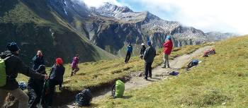 Group stop for relaxing views on the way to Grand Col Ferret | Kerren Knighton