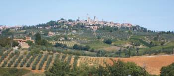 Classic Tuscan countryside with the towers of San Gimignano in the distance | Chris Viney