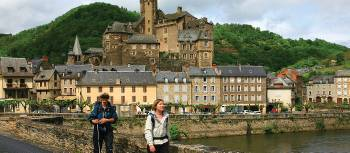 Hikers leaving Estaing on the Way of St James